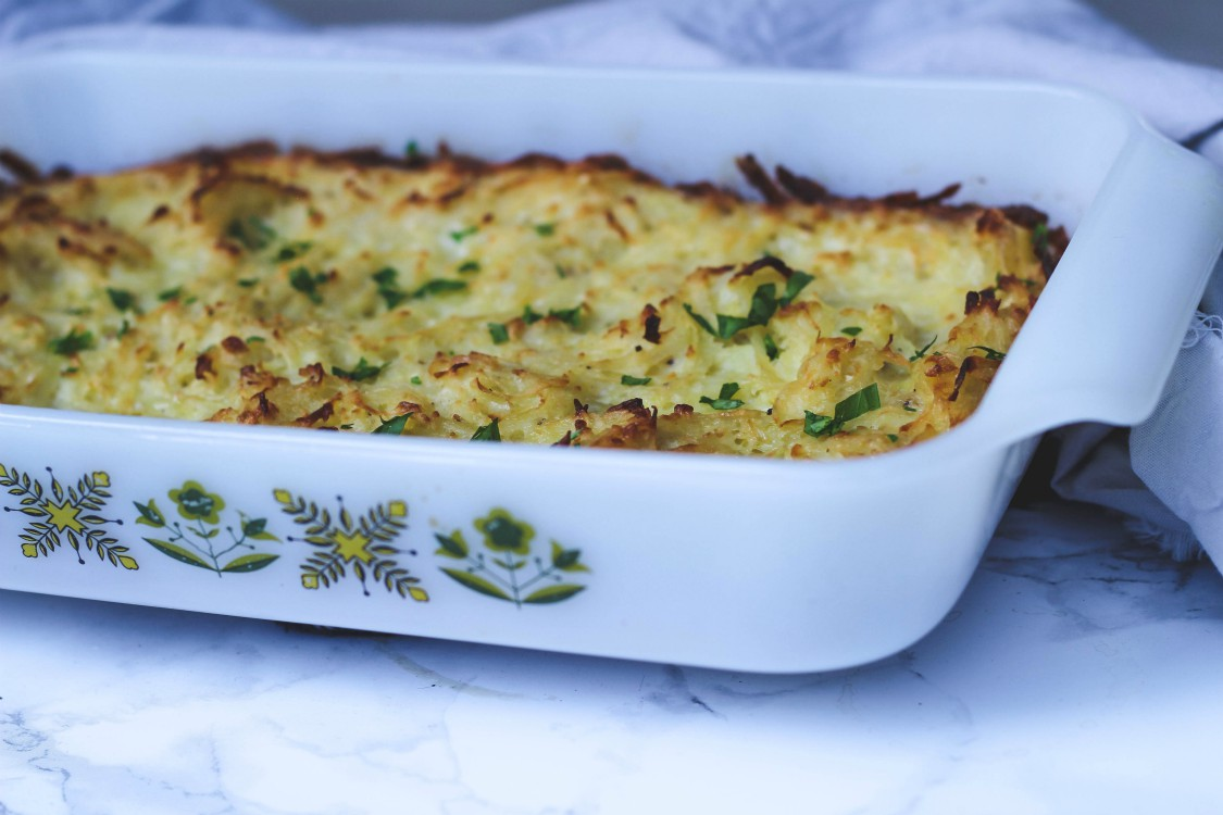 overhead image of potato kugel in white casserole