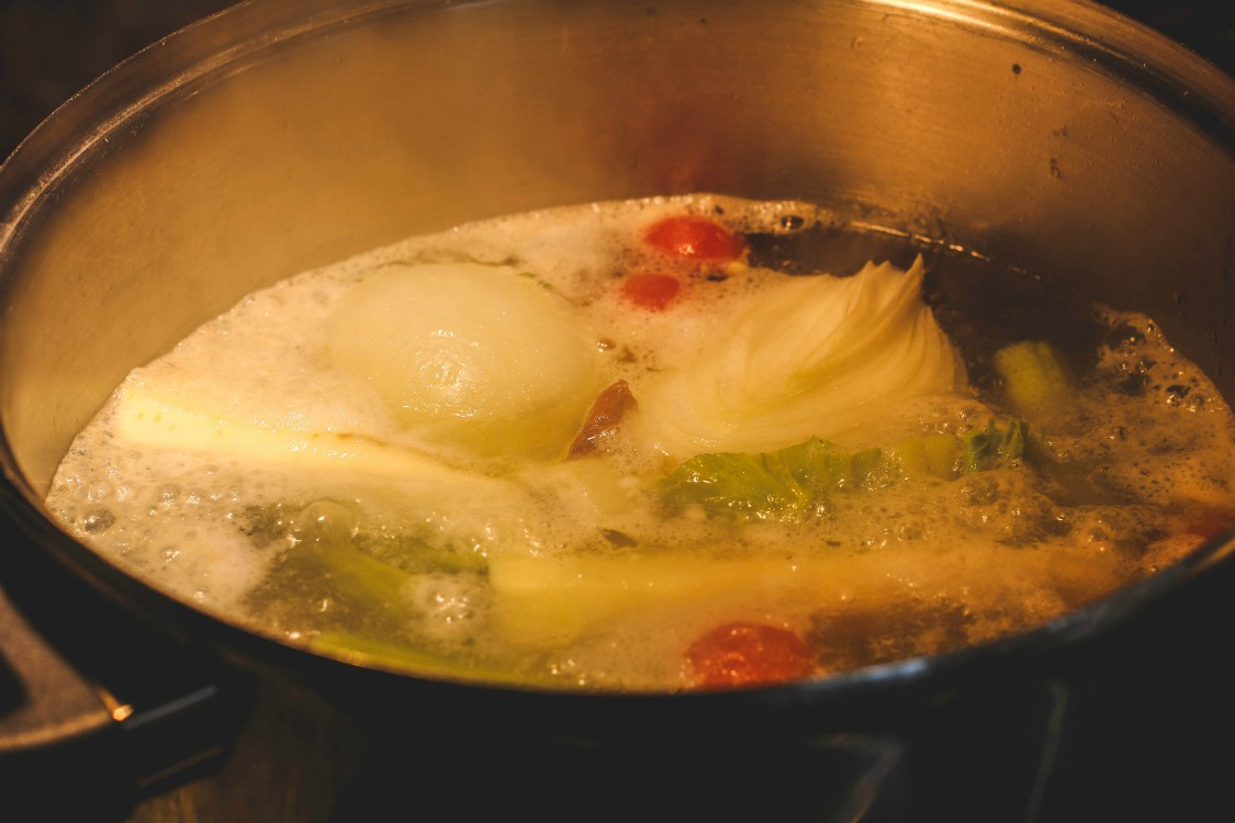 overhead image of soup simmering in pot