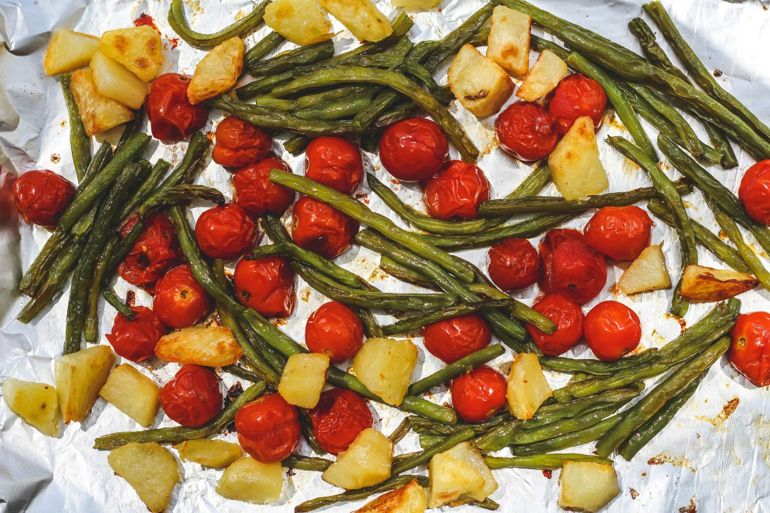 overhead image of roasted vegetables on a sheet pan