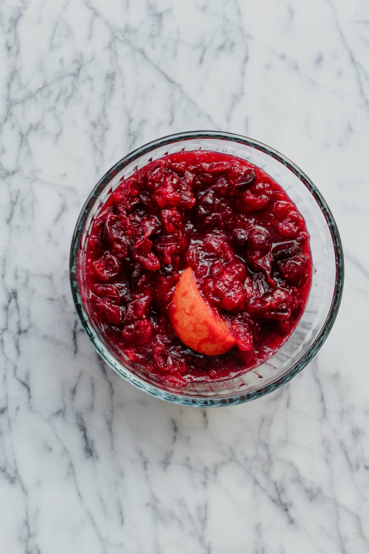 overhead image of fresh cranberry sauce in glass bowl