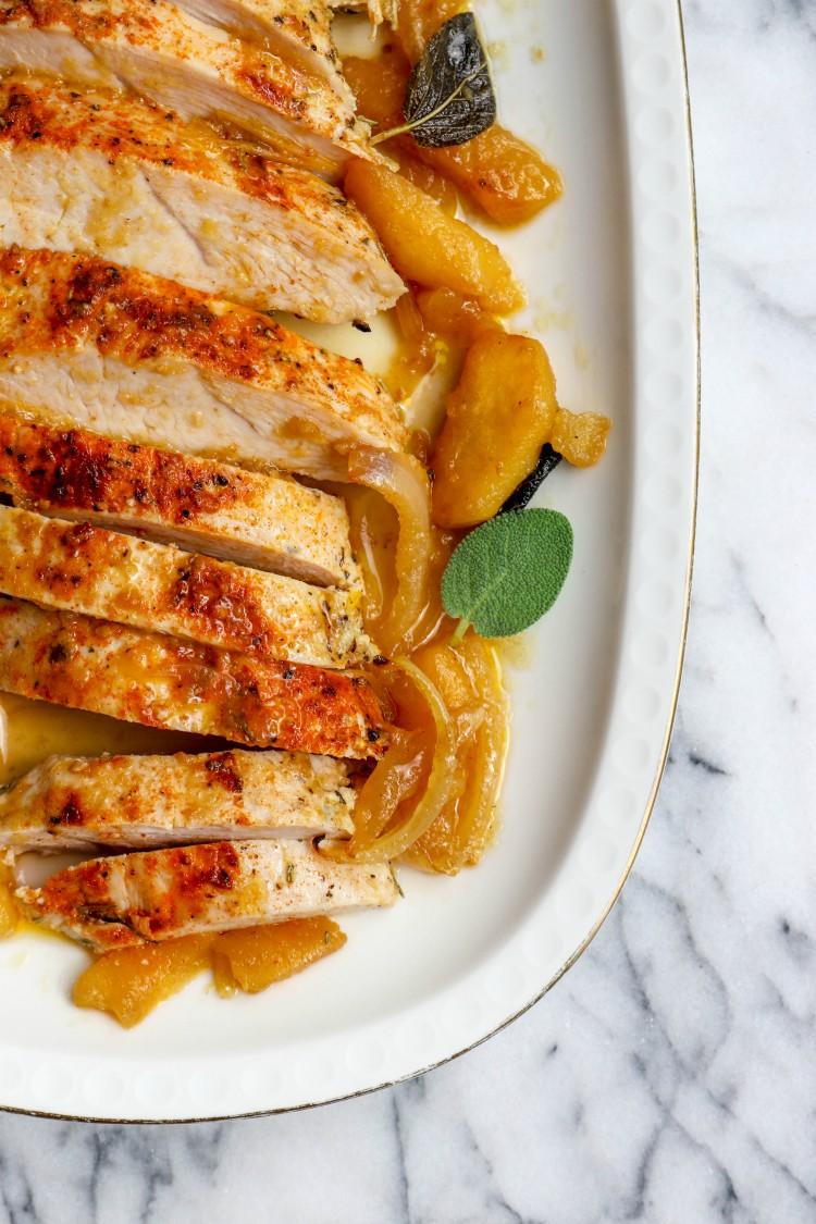 overhead image of apple and onion braised turkey tenderloin on white plate