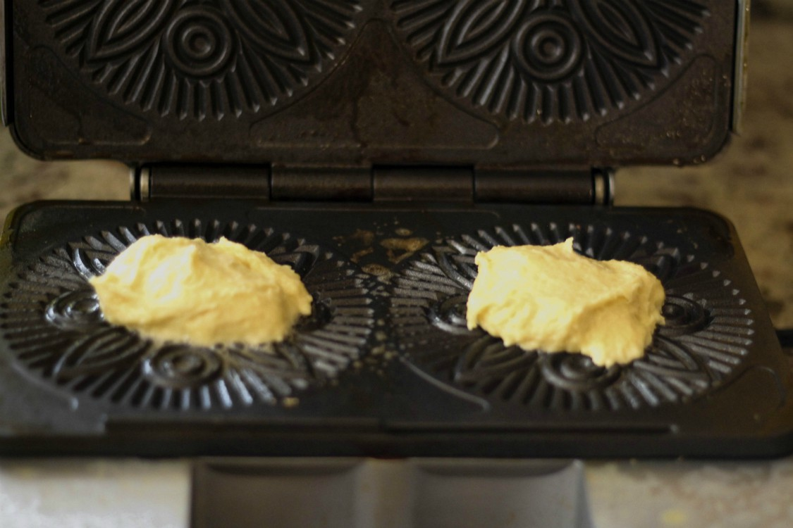 overhead image of pizzelle batter on rion