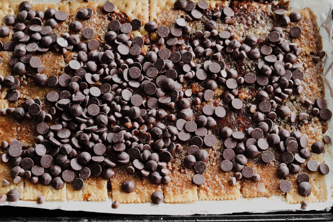 overhead image of chocolate chips on crackers