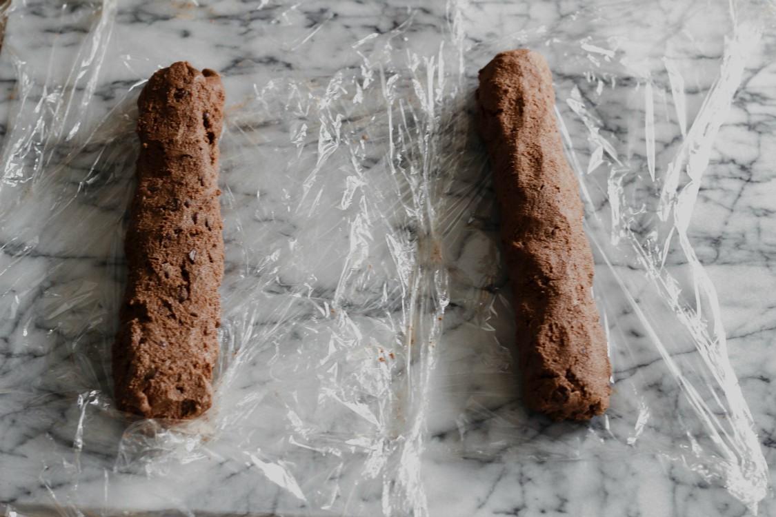 overhead image of chocolate logs on plastic wrap