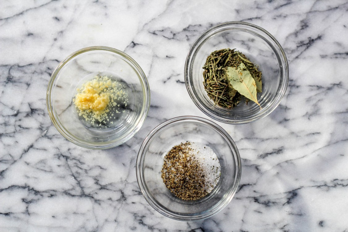 overhead image of pasta e ceci herb prep in glass bowls