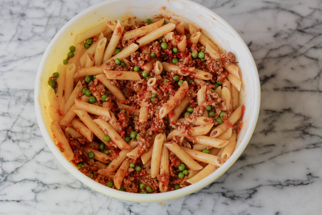 overhead image of pasta and meat sauce in a bowl