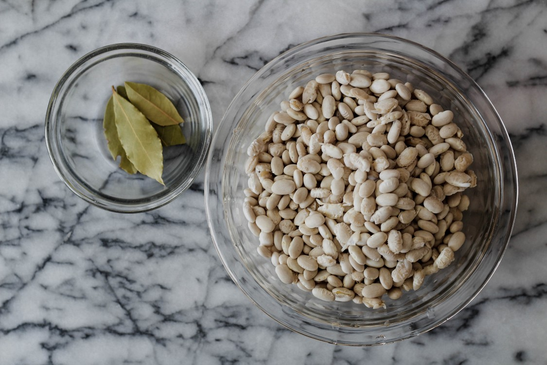 image of beans and bay leaves in glass bowls
